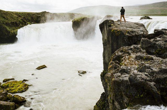 person-stream-cliff-river